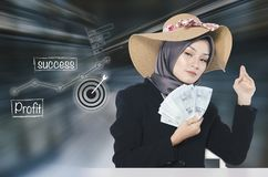 Young business woman holding banknote over abstract background with symbols Stock Photo